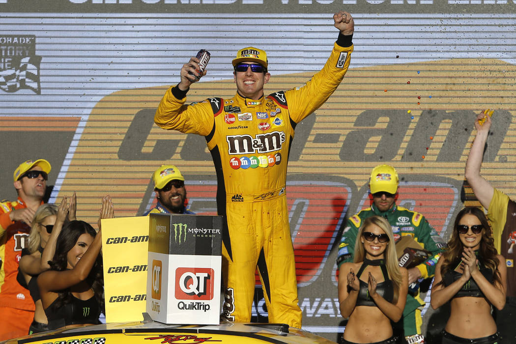 Kyle Busch (18) celebrates after winning a NASCAR Cup Series auto race on Sunday, Nov. 11, 2018, in Avondale, Ariz. (AP Photo/Rick Scuteri)