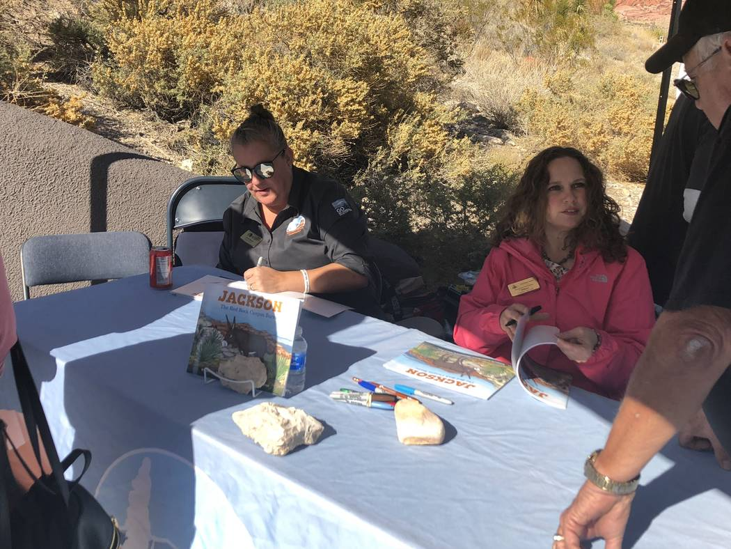 """Author Leonie Mowat and illustrator Allison Sosa sign copies of their children's book, """"Jackson: The Red Rock Canyon Burro"""" at a book-signing at Red Rock Canyon on Saturday, November 10, 2018. (Ja ..."""
