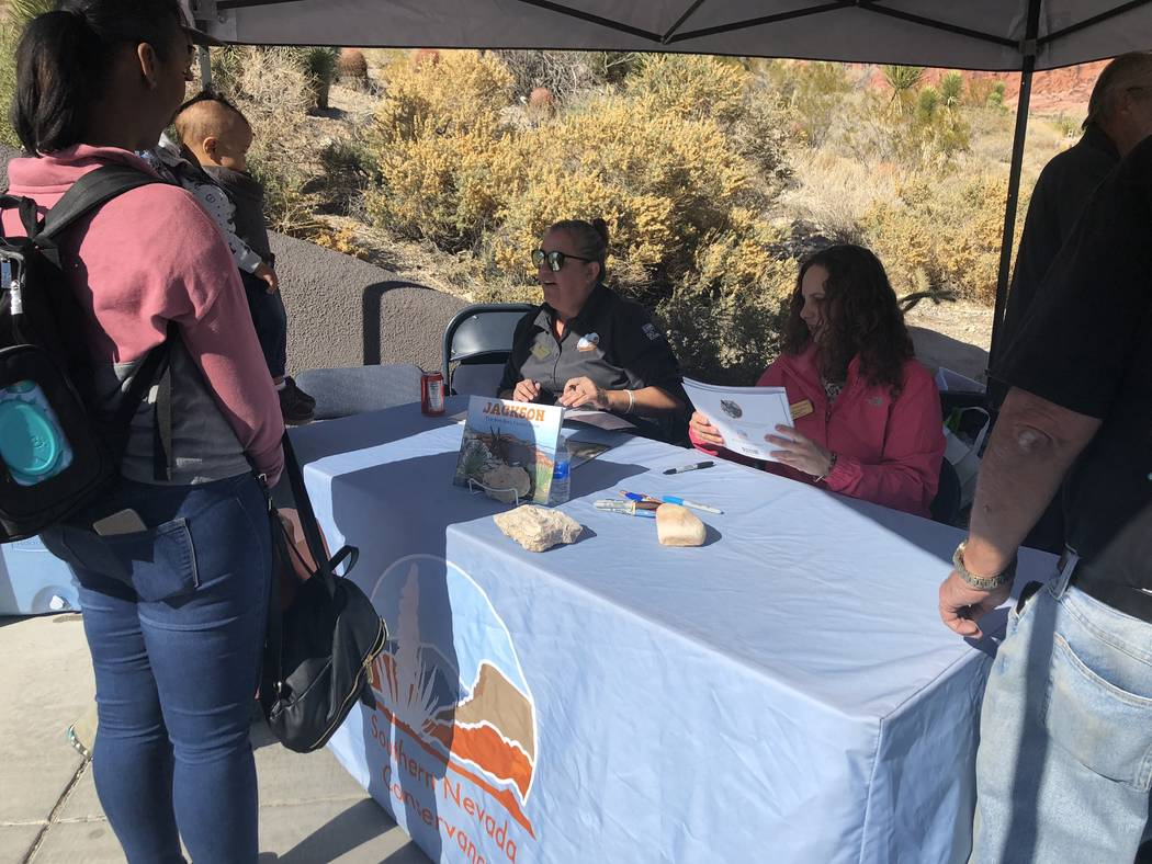 """Author Leonie Mowat and illustrator Allison Sosa sign copies of their children's book, """"Jackson: The Red Rock Canyon Burro"""" for Keanna, Eric and Bryce Hokanson at a book-signing at Red Rock Canyon ..."""