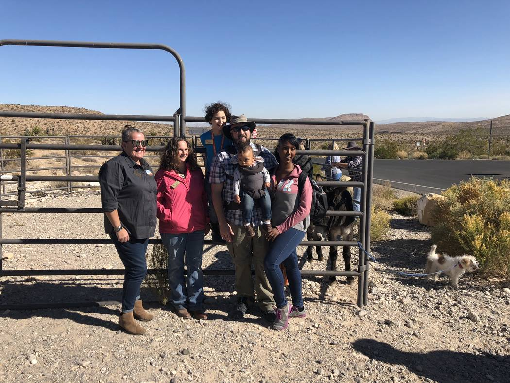 """Author Leonie Mowat and illustrator Allison Sosa of, """"Jackson: The Red Rock Canyon Burro"""" pose for a photograph with Keanna, Eric and Bryce Hokanson at a book-signing at Red Rock Canyon on Saturda ..."""