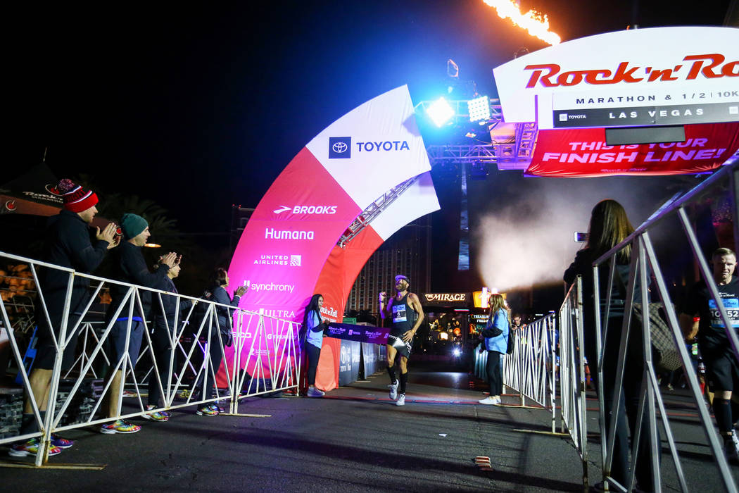 First place finisher Thomas Puzey crosses the finish line with a time of during the 2018 Rock 'n' Roll Marathon on the Strip in Las Vegas, Sunday,Nov. 11, 2018. Caroline Brehman/Las Vegas Review-J ...