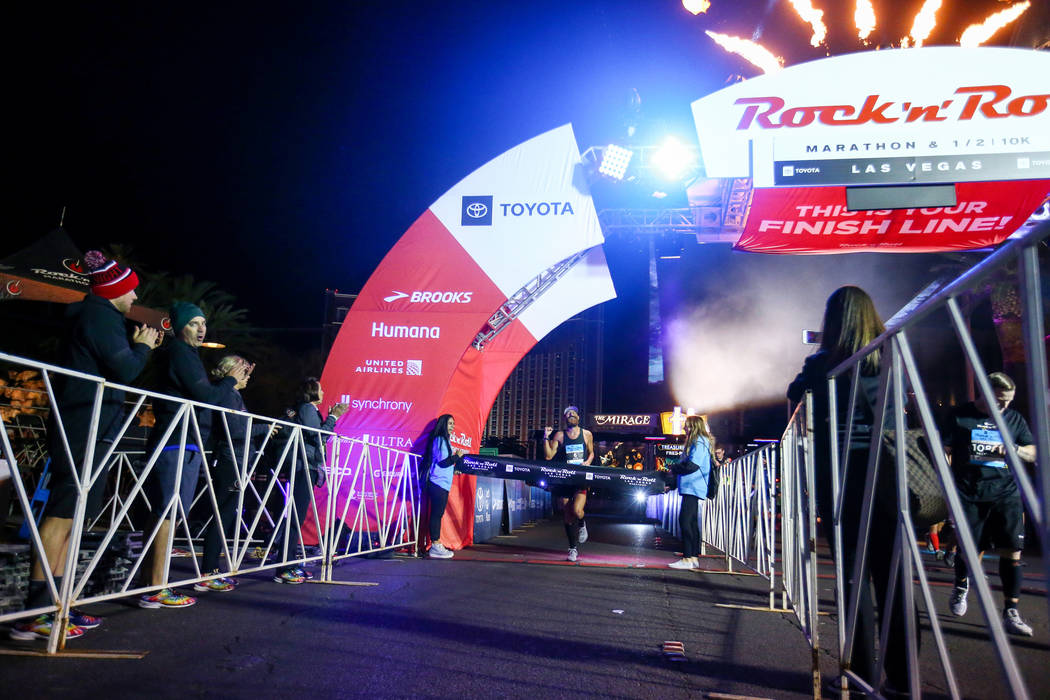 First place finisher Thomas Puzey crosses the finish line during the 2018 Rock 'n' Roll Marathon on the Strip in Las Vegas, Sunday,Nov. 11, 2018. Caroline Brehman/Las Vegas Review-Journal