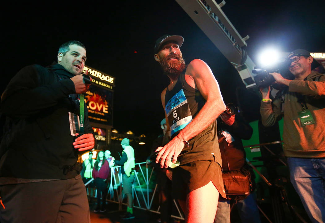 First place finisher Thomas Puzey looks back moments after crossing the finish line during the 2018 Rock 'n' Roll Marathon on the Strip in Las Vegas, Sunday,Nov. 11, 2018. Caroline Brehman/Las Veg ...