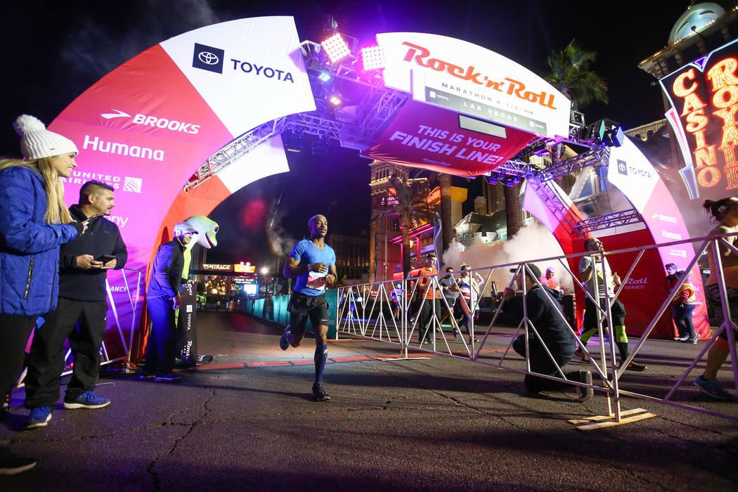 Second place finisher Yonatan Abebe crosses the finish line during the 2018 Rock 'n' Roll Marathon on the Strip in Las Vegas, Sunday,Nov. 11, 2018. Caroline Brehman/Las Vegas Review-Journal