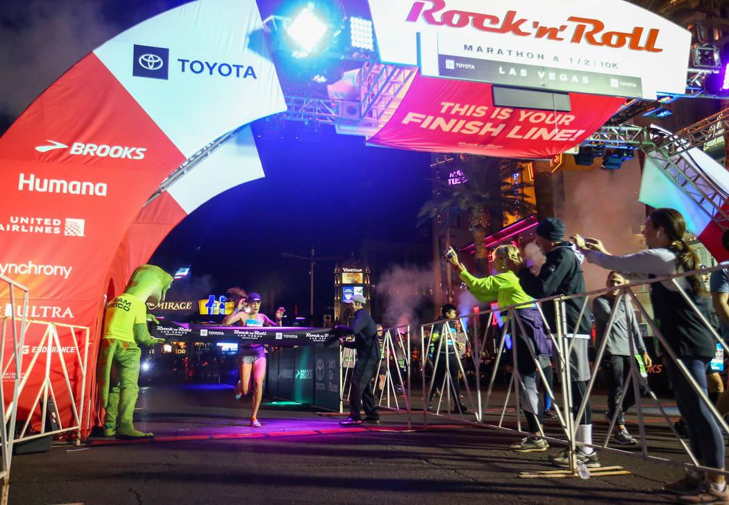 First place women's finisher Hannah McInturff crosses the finish line during the 2018 Rock 'n' Roll Marathon on the Strip in Las Vegas, Sunday,Nov. 11, 2018. Caroline Brehman/Las Vegas Review-Journal