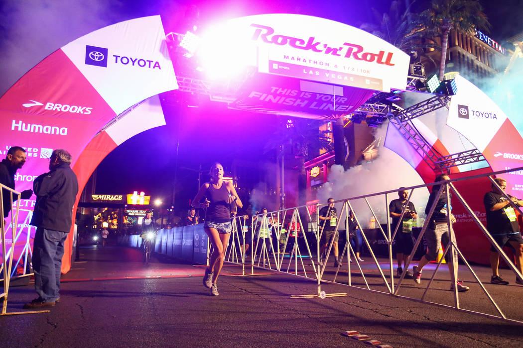 Second place women's finisher Jessica Sams crosses the finish line during the 2018 Rock 'n' Roll Marathon on the Strip in Las Vegas, Sunday,Nov. 11, 2018. Caroline Brehman/Las Vegas Review-Journal