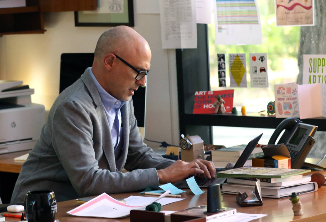 Joshua Wolf Shenk, artistic and executive director of the Beverly Rogers, Carol C. Harter Black Mountain Institute at UNLV, works at his office on Wednesday Nov. 7, 2018, in Las Vegas. (Bizuayehu ...