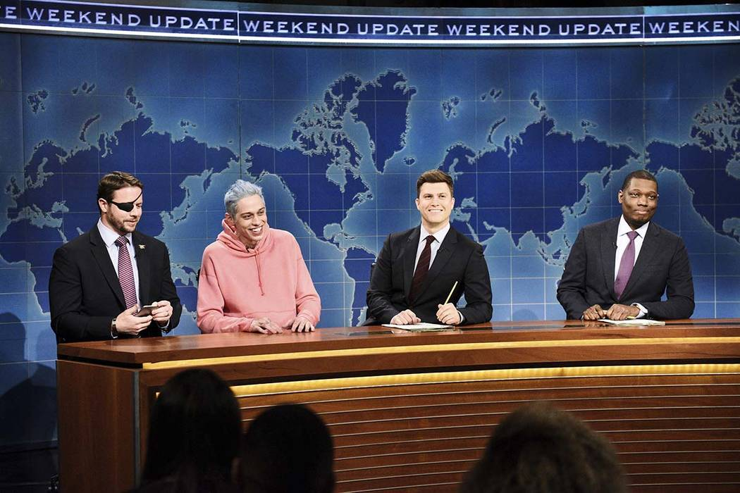 "In this Nov. 10, 2018 photo, Lt. Com. Dan Crenshaw, from left, a congressman-elect from Texas, Pete Davidson, Anchor Colin Jost, and Anchor Michael Che appear on ""Saturday Night Live"" in New York. ..."