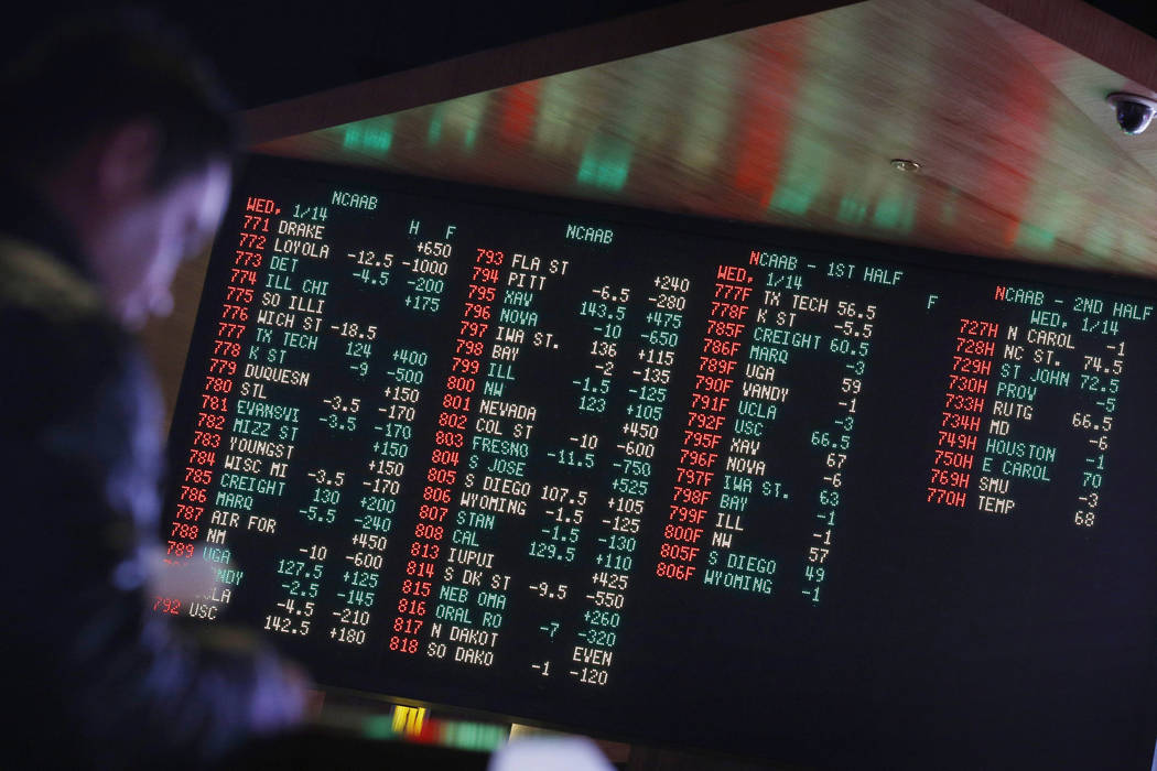 Odds are displayed on a screen at a sports book owned and operated by CG Technology in Las Vegas in this file photo. (AP Photo/John Locher)