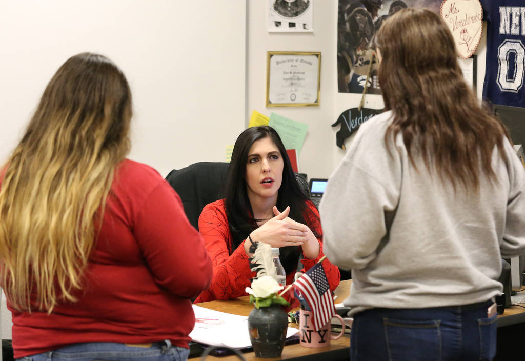 Tara Verderosa, center, a journalism teacher at Spring Valley High School, talks to her students Sienna Caraballo, left, and Nova Riley during a journalism class on Tuesday, Nov. 13, 2018, in Las ...