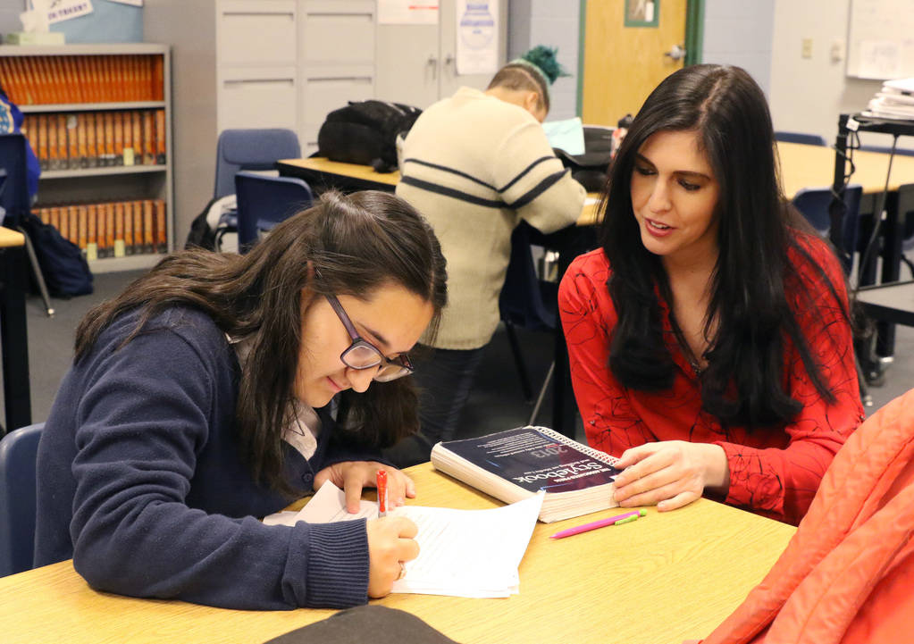 Hana Helfand, left, copy editor of the Grizzly Growler student newspaper, edits stories as Tara Verderosa, a journalism teacher at Spring Valley High School, looks on during a journalism class on ...