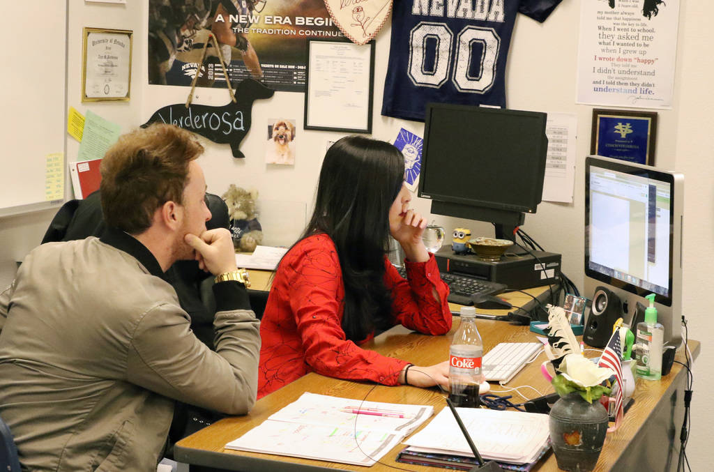 Tara Verderosa, a journalism teacher at Spring Valley High School, and Donovan Souder, editor-in-chief of the Grizzly Growler, student newspaper, edit stories during a journalism class on Tuesday, ...