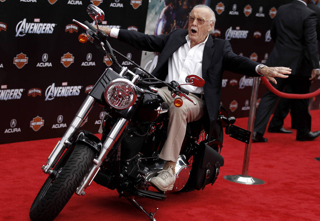 """FILE - In this April 11, 2012, file photo,Stan Lee arrives at the premiere of """"The Avengers"""" in Los Angeles. Comic book genius Lee, the architect of the contemporary comic book, has died ..."""