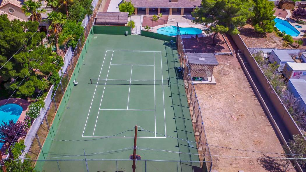 Of course, the childhood home of Andre Agassi has a regulation-sized tennis court. (Xpand Realty)