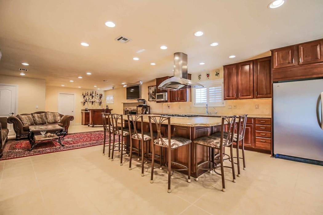 The remodeled kitchen is adjacent to the great room. (Xpand Realty)