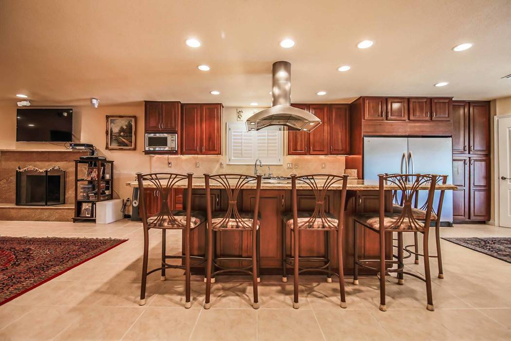 The kitchen showcases a large island with seating. (Xpand Realty)