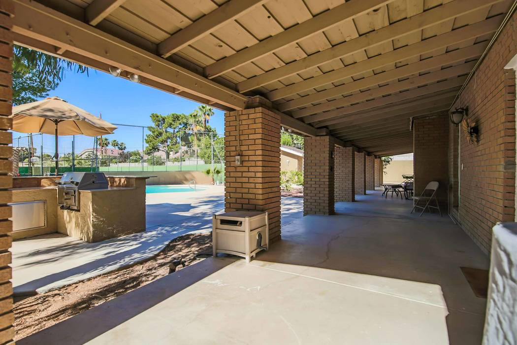 The home has an outdoor kitchen and patio. (Xpand Realty)