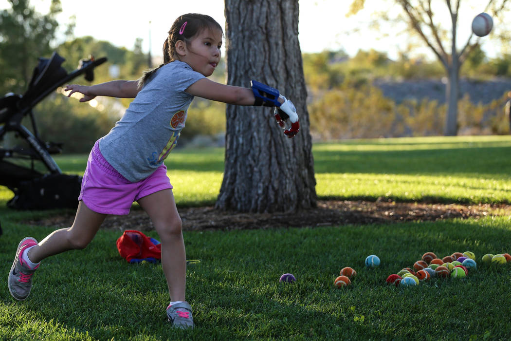 Hailey Dawson, 7, practices her pitch for the MLB World Series opener during a session at Anthem Park in Henderson, Thursday, Oct. 19, 2017. A group of researches at University of Las Vegas create ...