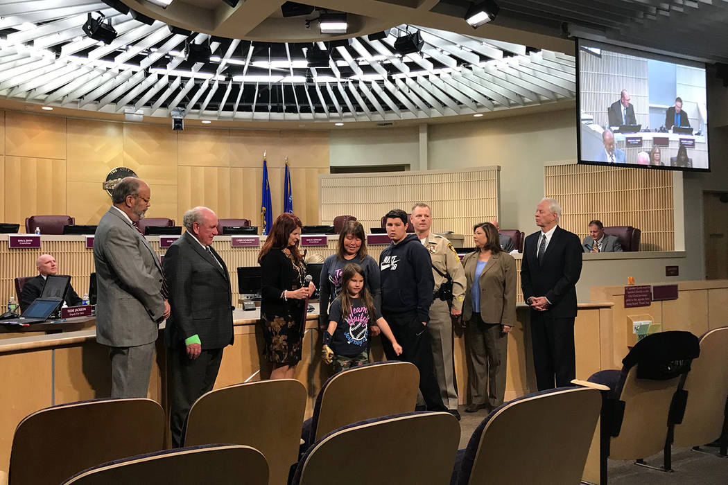 The Henderson City Council recognizes Tuesday, Nov. 20, 2018, as Hailey Dawson Day. Hailey, 8, is in the center. (Blake Apgar/Las Vegas Review-Journal)