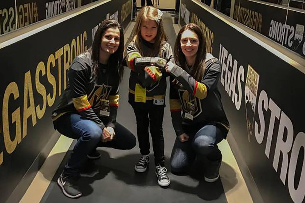 Maria Gerardi, Hailey Dawson and Gerardi's wife, Sidnee Schaefer, pose at a Golden Knights game. (Yong Dawson)