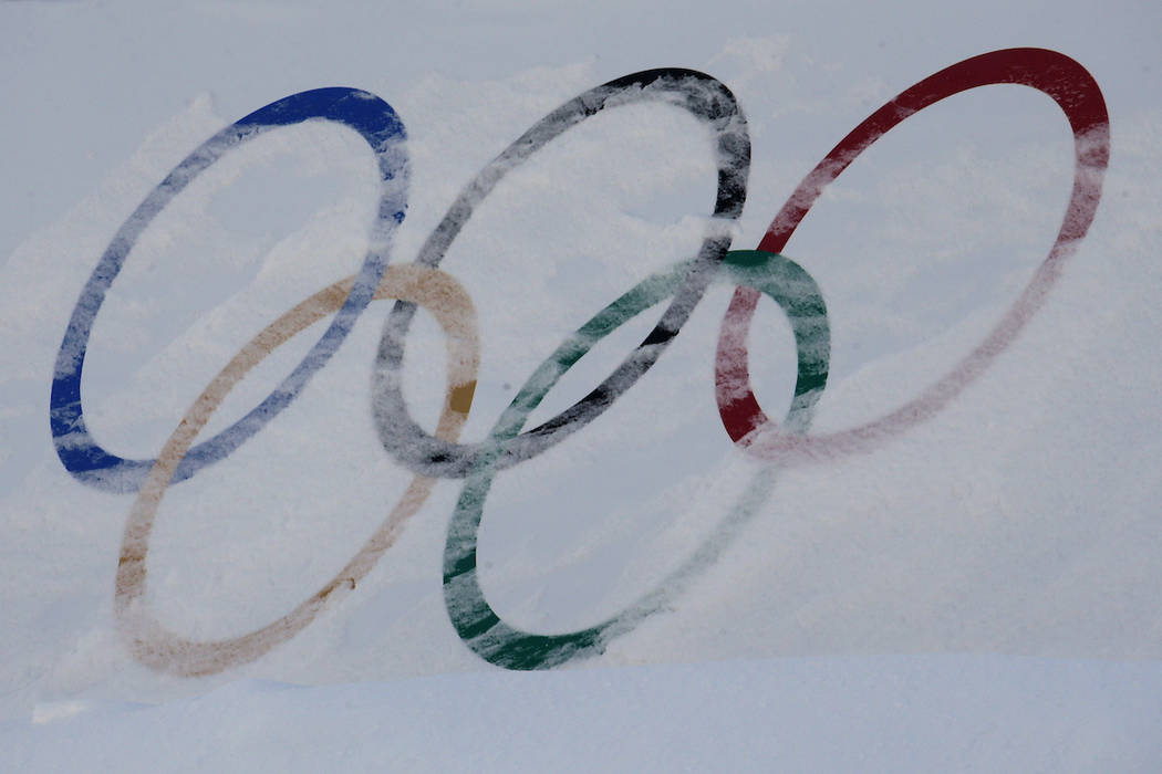 Olympic rings are covered with fresh snow at the Phoenix Snow Park as preparations continue for the 2018 Winter Olympics in Pyeongchang, South Korea, Saturday, Feb. 3, 2018. (AP Photo/Charlie Riedel)