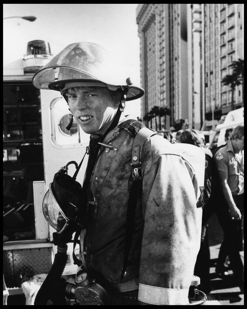 An unidentified Clark County Firefighter is pictured at the November 21, 1980 MGM Grand Hotel fire. Over 200 firefighters responded to the blaze. Initial responders arrived on scene to find hotel ...