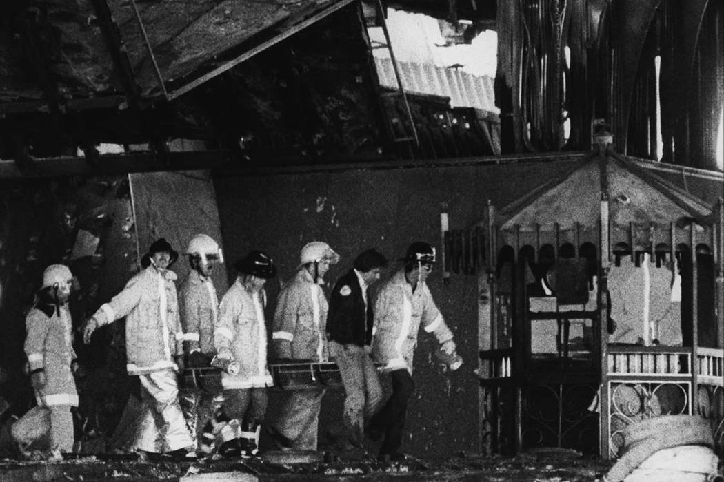 Clark County Firefighter remove a body from the entrance of the MGM Grand following the November 21, 1980 MGM Grand Hotel fire. Over 200 firefighters responded to the blaze. Initial responders arr ...
