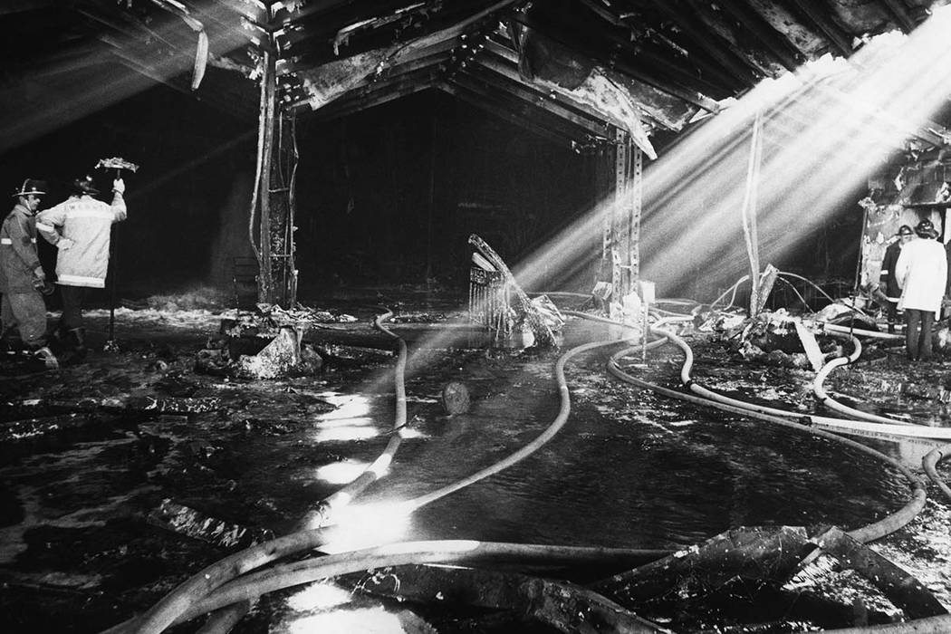 The graphic aftermath of the November 21, 1980 MGM Grand Hotel fire can be seen in this view of a portion of the hotels entrance. The fire initiated in an area above a delicatessen on the main flo ...