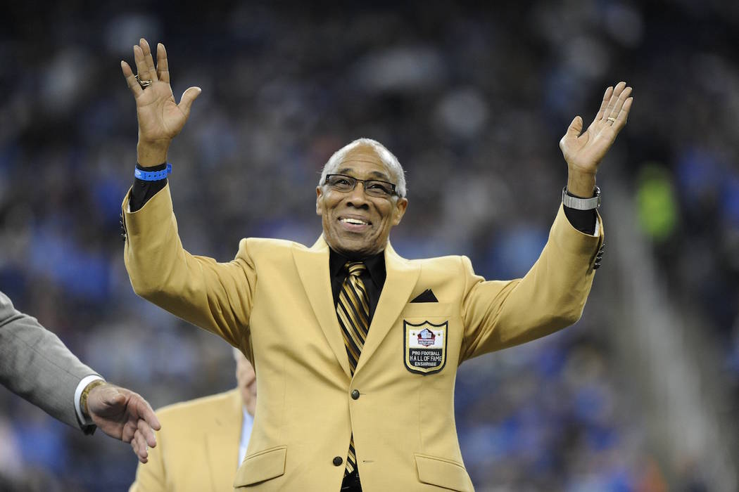 In this Oct. 18, 2015, file photo, former Detroit Lions defensive back Lem Barney acknowledges the crowd after receiving a Pro Football Hall of Fame ring during halftime of an NFL football game in ...
