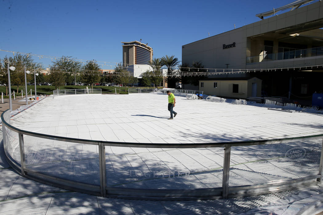 Workers construct the Rock Rink temporary ice rink at The Lawn in Downtown Summerlin in Las Vegas Tuesday, Nov. 6, 2018. K.M. Cannon Las Vegas Review-Journal @KMCannonPhoto