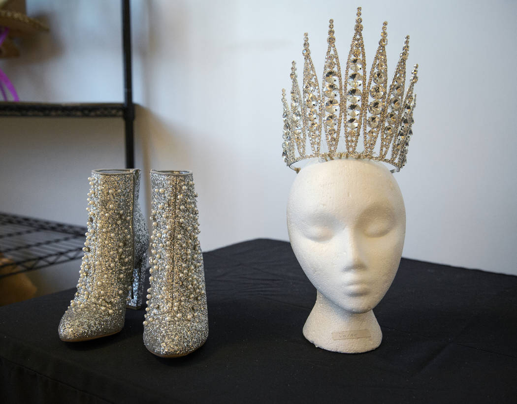 The shoes and crown that go along with the character costume for the Snow Queen float is on display in preparation for the annual Downtown Summerlin holiday parade in Las Vegas, Wednesday, Nov. 14 ...