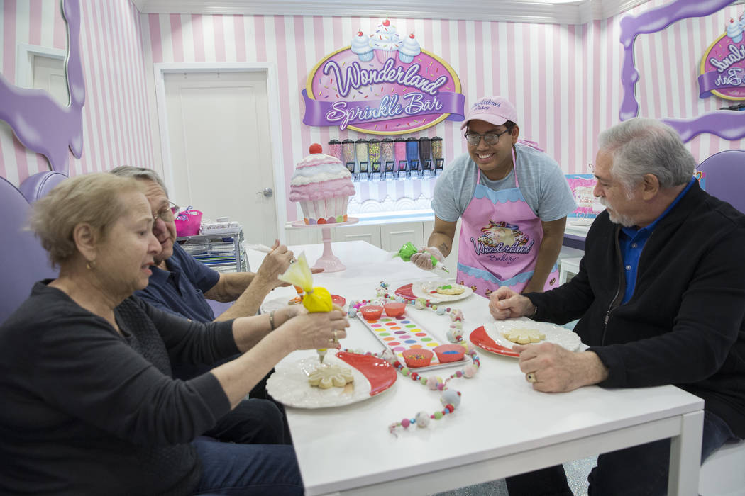 Diego Simon, second from right, helps Alan and Sharon Lubin and Bruce Ventimiglia design cookies at Wonderland Bakery on Wednesday, November 14, 2018, in Las Vegas. Benjamin Hager Las Vegas Review ...