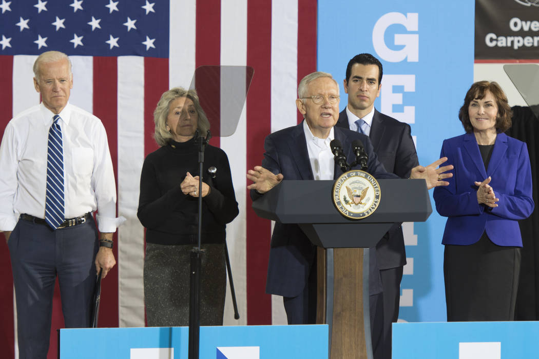 U.S. Sen. Harry Reid, D-Nev., center, introduces Vice President Joe Biden during a campaign rally for presidential candidate Hillary Clinton at the Southwest Regional Council of Carpenters office ...