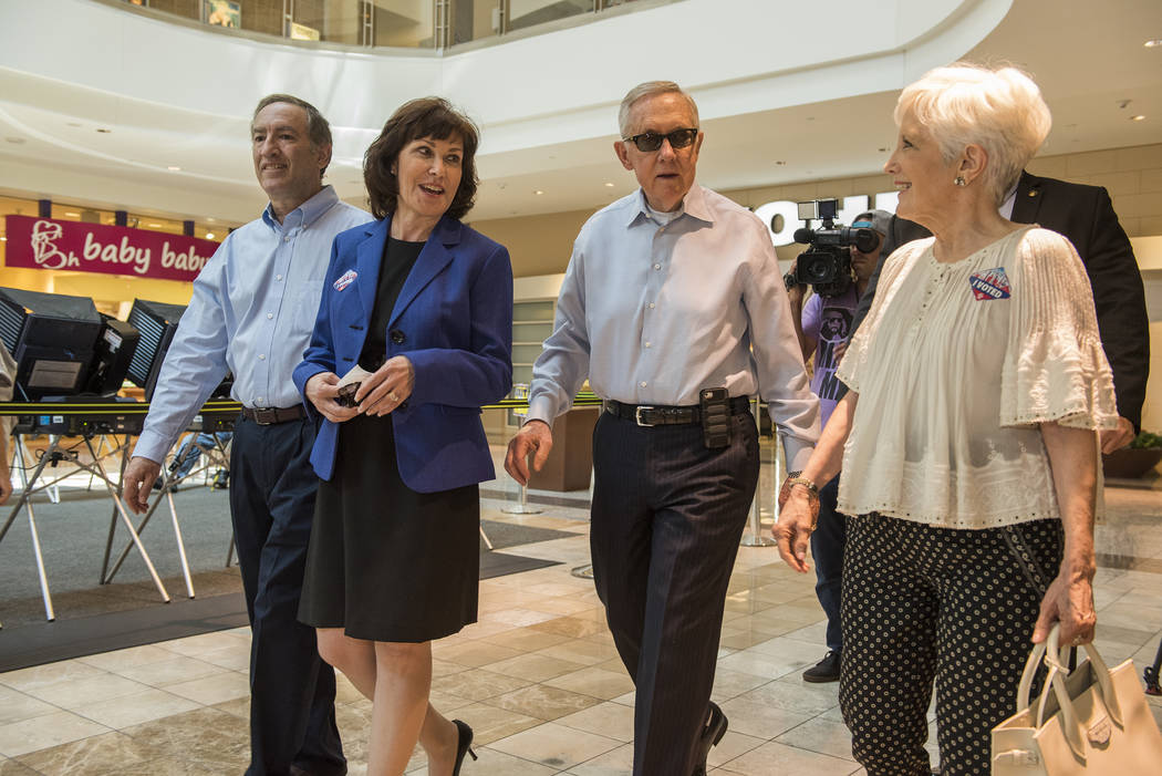 Jacky Rosen and U.S. Senator Harry Reid are seen walking with their spouses Larry, left, and Landra, right after voting at the Galleria Mall at Sunset in Henderson, Nev., on Thursday, June 2, 2016 ...