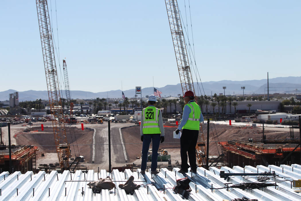 Don Webb, left, chief operating officer of the LV Stadium Co., with Rick Velotta, reporter for the Las Vegas Review-Journal, gives a tour of a quiet Raiders stadium construction site in Las Vegas ...