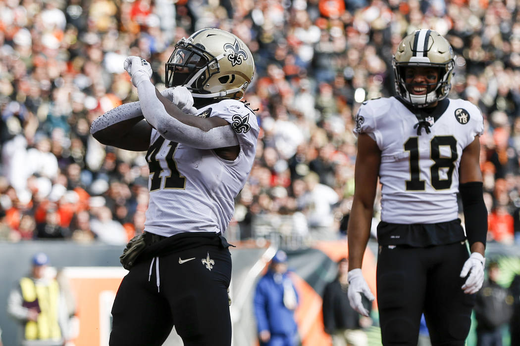New Orleans Saints running back Alvin Kamara (41) reacts after scoring a touchdown in the first half of an NFL football game against the Cincinnati Bengals, Sunday, Nov. 11, 2018, in Cincinnati. ( ...