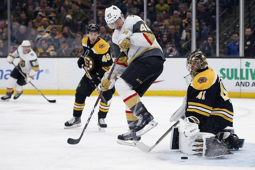 Vegas Golden Knights' Ryan Carpenter (40) screens the shot on Boston Bruins' Jaroslav Halak (41) during the third period of an NHL hockey game in Boston, Sunday, Nov. 11, 2018. (AP Photo/Michael D ...
