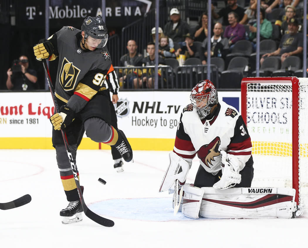 Golden Knights left wing Tomas Nosek (92) looks to get the puck in against Arizona Coyotes goaltender Darcy Kuemper (35) during the first period of a preseason NHL hockey game at T-Mobile Arena in ...