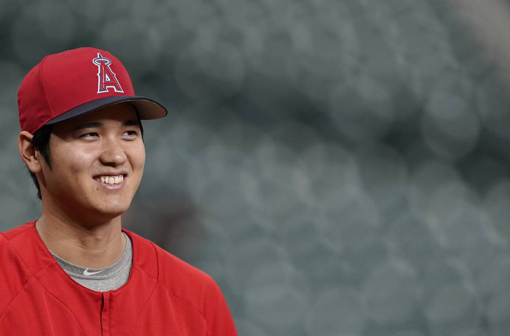 In this Sept. 21, 2018 photo Los Angeles Angels' Shohei Ohtani, of Japan, waits to stretch during batting practice before a baseball game against the Houston Astros in Houston. Ohtani has been vot ...