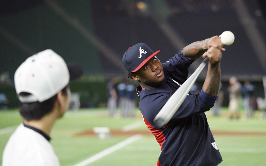 MLB All-Star Atlanta Braves' Ronald Acuna Jr. hits a ball to Japanese junior high school students during MLB All Stars Baseball clinic as part of All-Stars Series baseball games at Tokyo Dome in T ...