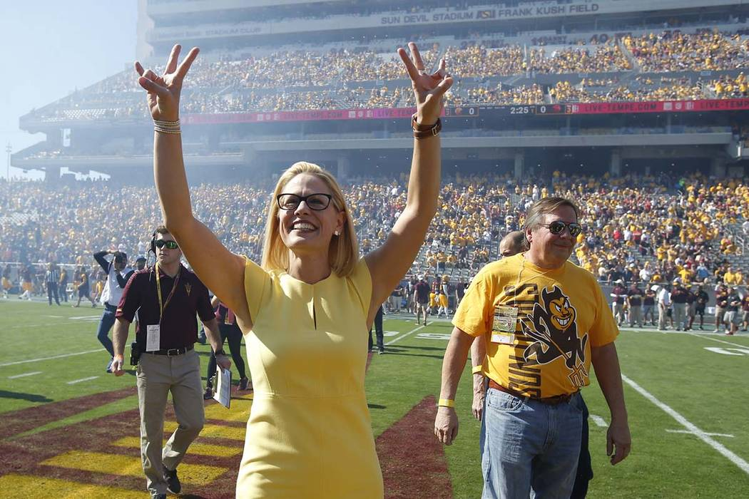 Kyrsten Sinema performs the coin toss before an NCAA college football game between Arizona State and Utah, Saturday, Nov 3, 2018, in Tempe, Ariz. (Rick Scuteri/AP)