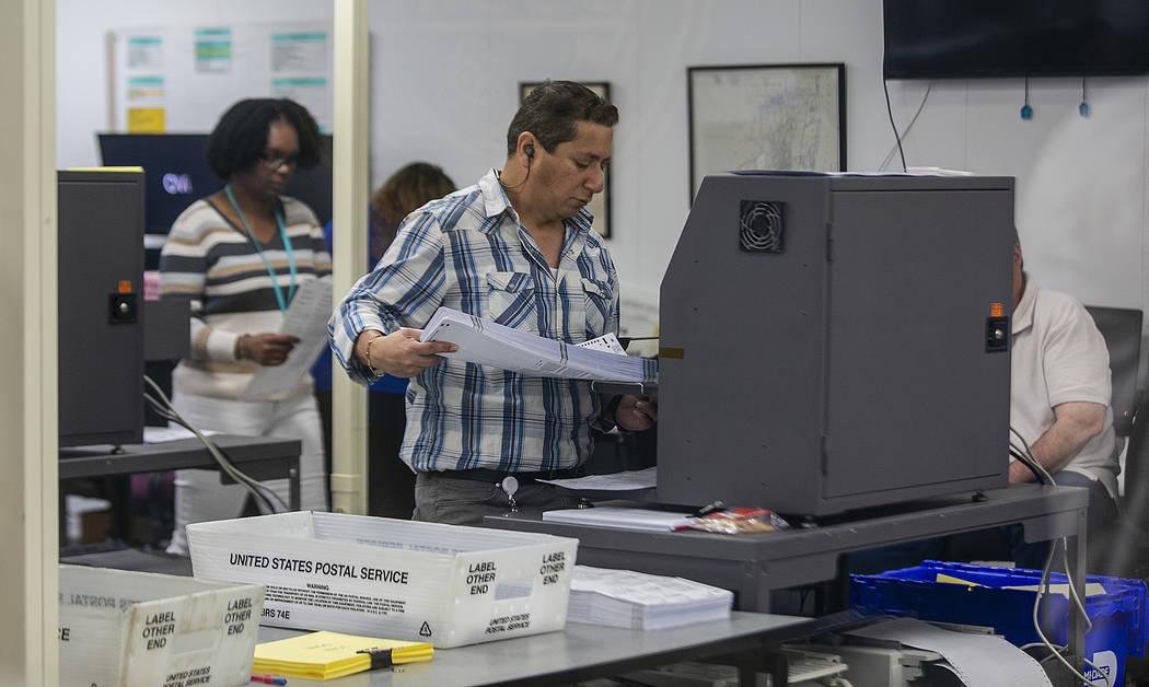 Miami-Dade Election Center supervisors recount the ballots and are already halfway through the recount on Monday, Nov. 12, 2018. (C.M. Guerrero/Miami Herald via AP)