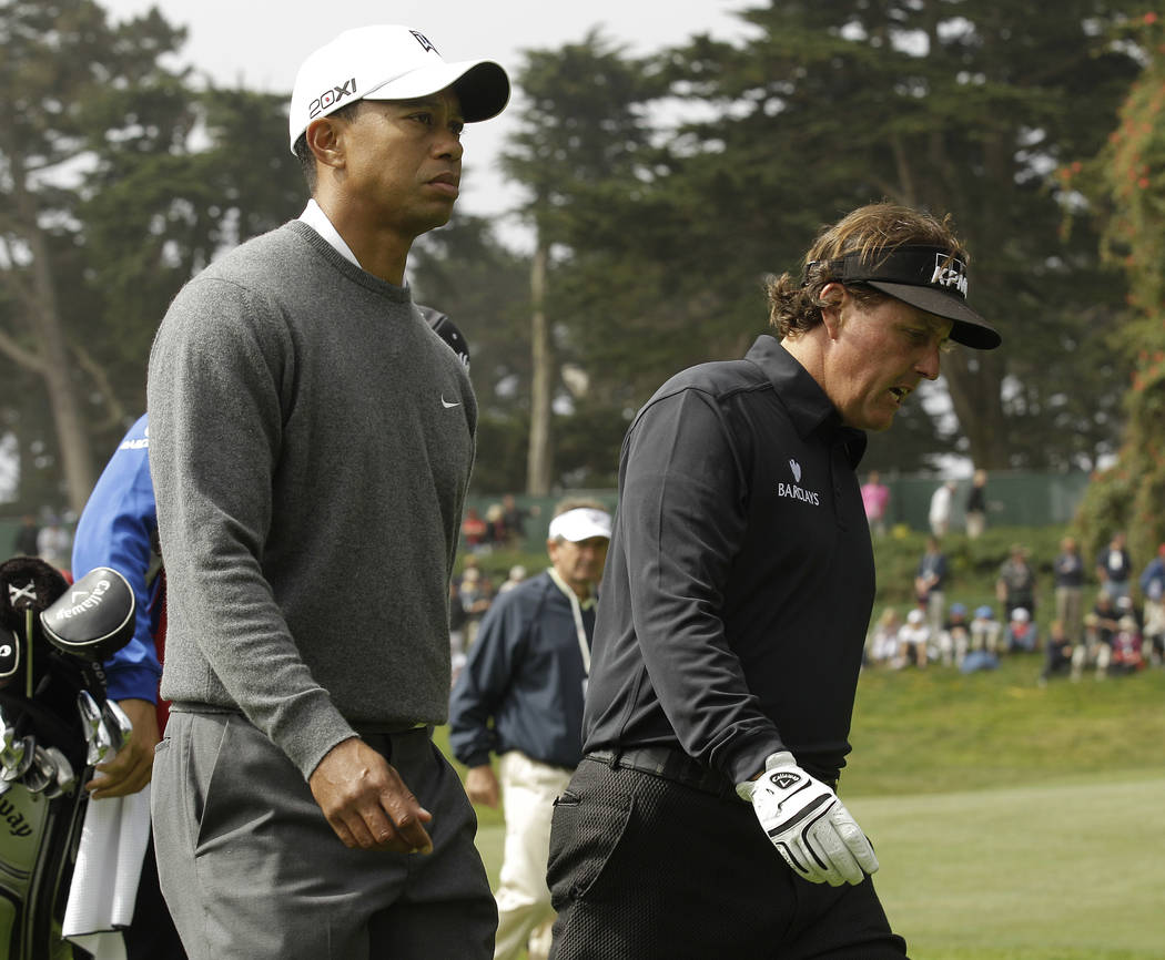 Phil Mickelson and Tiger Woods make their way to the 18h hole during the first round of the U.S. Open Championship golf tournament Thursday, June 14, 2012, at The Olympic Club in San Francisco. (A ...