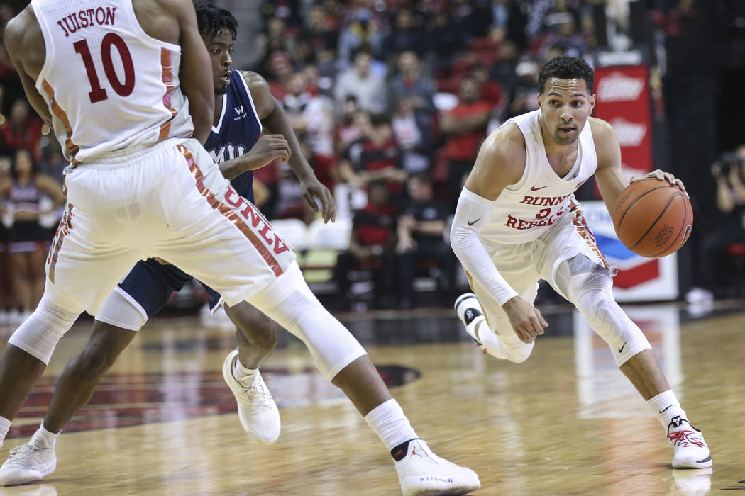 UNLV Rebels guard Noah Robotham (5) brings the ball up court against Loyola Marymount during the first half of a season-opening basketball game at the Thomas & Mack Center in Las Vegas on Satu ...