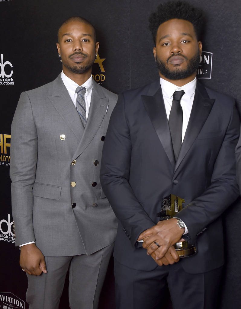 """Michael B. Jordan, left, and Ryan Coogler, winners of the Hollywood film award for """"Black Panther,"""" pose in the press room at the Hollywood Film Awards on Sunday, Nov. 4, 2018, at the Be ..."""