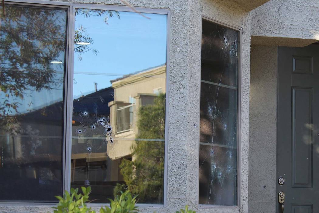 Bullet holes mark the windows of a house in the 6700 block of Courtney Michelle Street of North Las Vegas that was hit by gunfire, killing an 11-year-old girl on Thursday night, Nov. 1, 2018. (Max ...