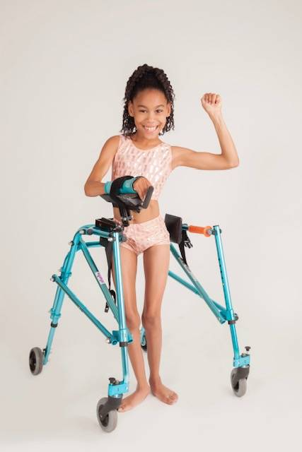 Nikki Green's daughter, Starr wearing one of the swimsuits in Green's clothing line. (Eric Ita)