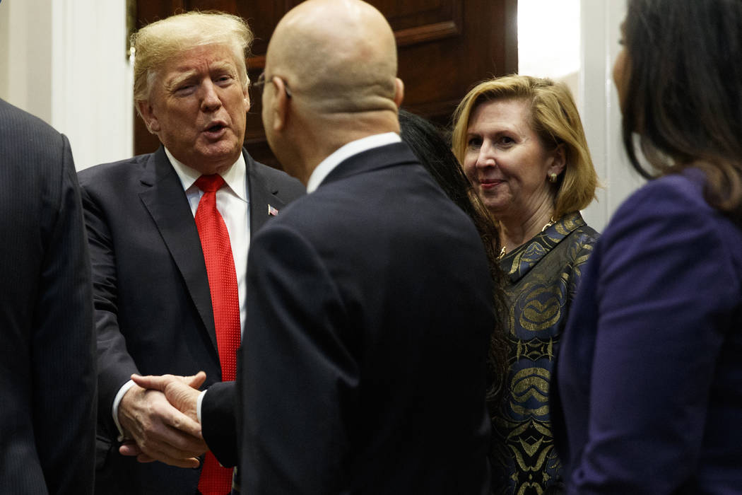 Deputy National Security Adviser Mira Ricardel, right, watches as President Donald Trump arrives for a Diwali ceremonial lighting of the Diya in the Roosevelt Room of the White House, Tuesday, Nov ...