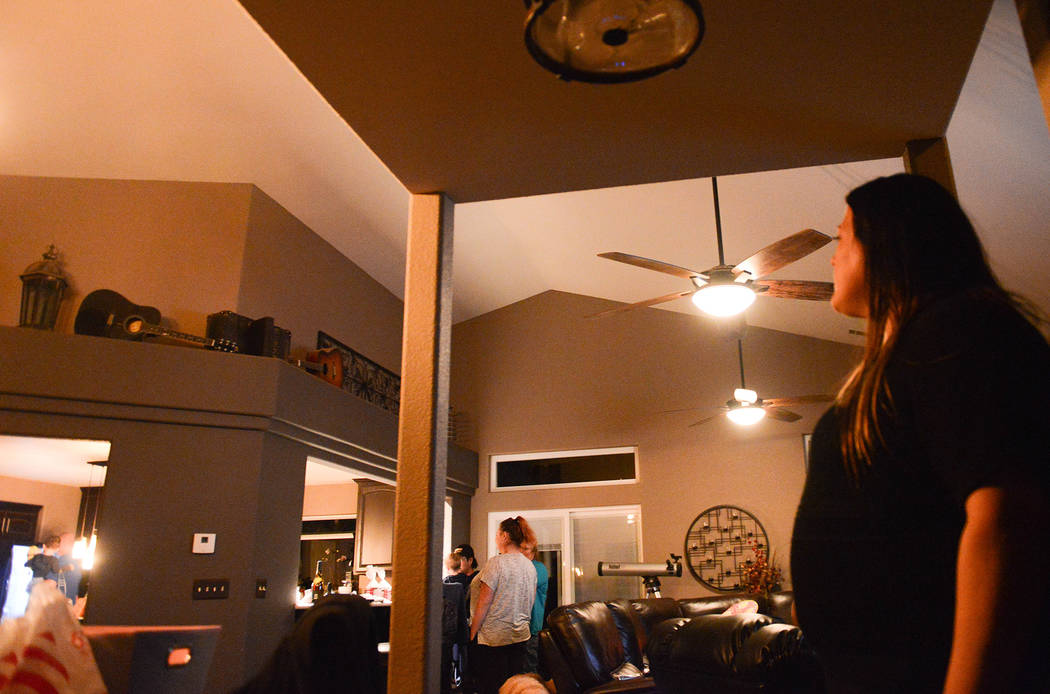 """Stacie Power looks on as her family members chat and prepare the """"line dinner"""" Tuesday, Nov. 13, 2018. The Route 91 Harvest Festival survivor now has 21 people and seven dogs living in ..."""