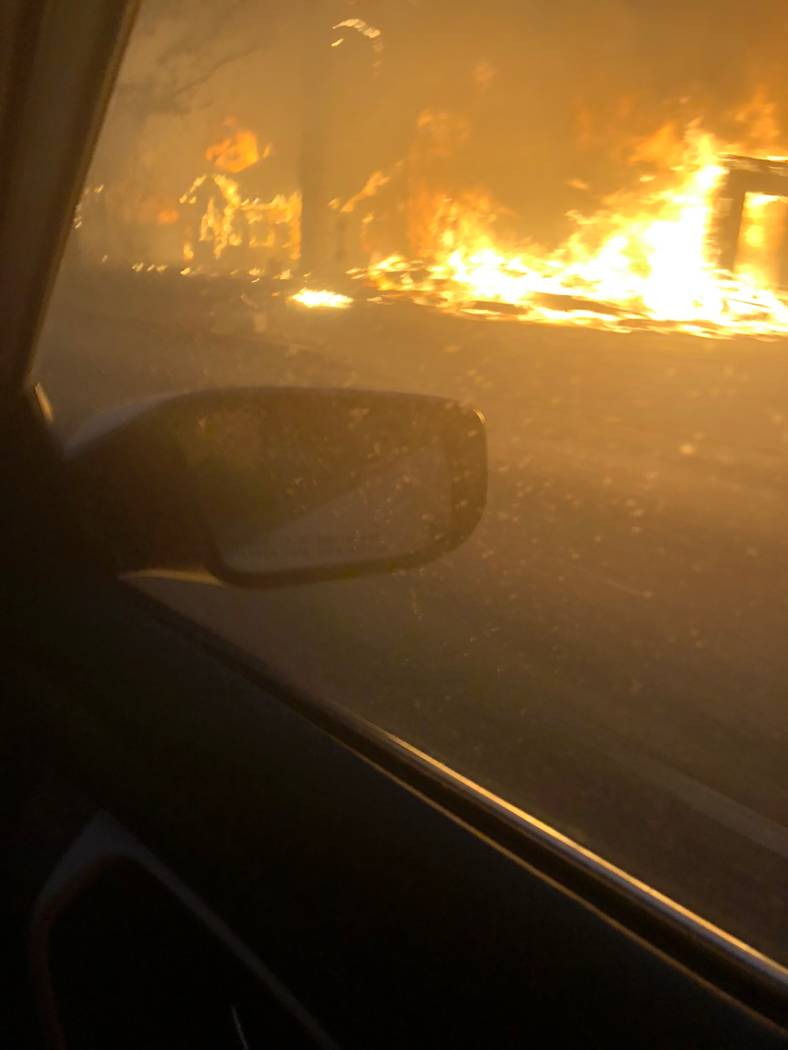 Flames from the Camp Fire surround Stacie Power's parents as a fire engine escorts them out of Paradise, California, and into nearby Chico, where Power lives, after her father ran out of oxygen. ( ...